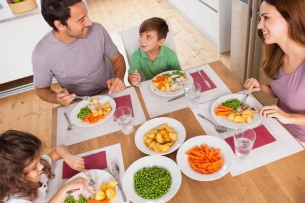 bigstock-family-smiling-around-a-health-40896751